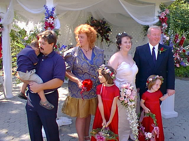 Image from L to R Michael (being shy), Lance, Anna (matron of honor) Maggie, Cheri, Jim & Erica